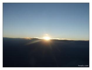 Sun rises at the horizon